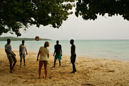 Amizade Volunteers Playing on the Beach