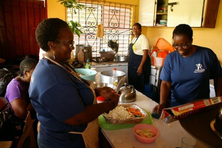 House Mothers in Jamaica Cooking for Amizade Volunteers