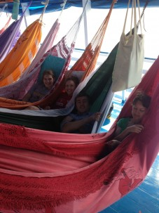 Amizade volunteers relaxing in hammock in Brazil