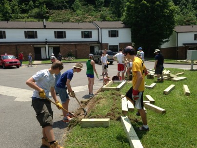 Amizade volunteers construct raised flower beds in Williamson, WV