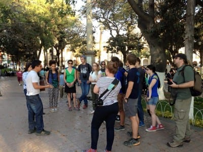 Ariel telling the group about the history and importance of La Plaza