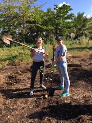 girls planting tree